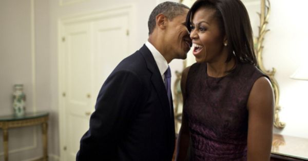BARACK OBAMA whishpering sweet nothings in Michelle's ear! cute
