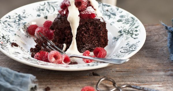 Chocolate fudge cake with raspberries and amaretto cream