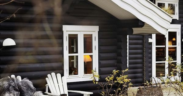 Black Stained Log Cabin With Great Deck Design And