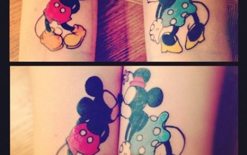 Vintage Mickey Mouse and Minnie Mouse in kiss at the wrist. If