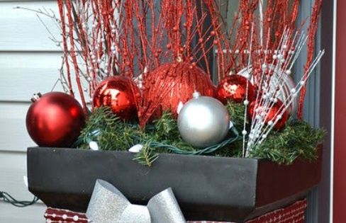 Front porch decor idea - Flower pots filled with evergreen garland, huge