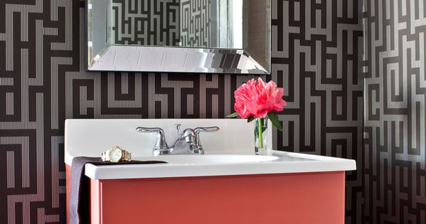 A coral bathroom vanity brings high-contrast charm to this small home design