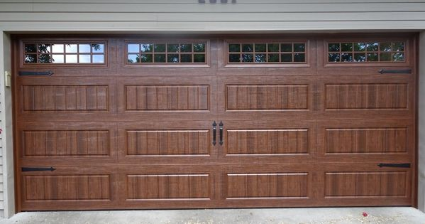 Amarr Hillcrest 3000 S Walnut Garage Door Installed By Augusta Garage Door In St Cloud Mn Steelgaragedoor Amarr Garage Doors Tan House Door Installation