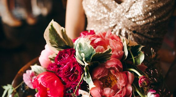 Gold wedding dress designed by the bride and vibrant pink and red bouquet | Photo by Christine Lim Photography