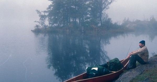 foggy morning by the lake with a canoe... boundary waters? :)