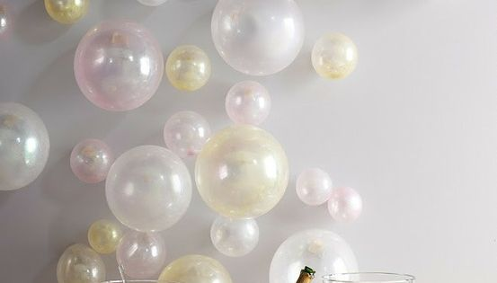 Love this balloons taped to a wall to resemble by bubbles for Champagne balloon wall