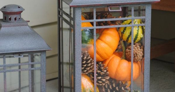 Mini pumpkins, gourds and pinecones in a lantern for Fall. This is