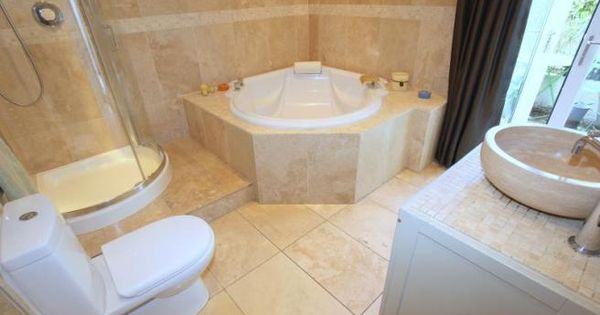 Limestone look tiles with corner bath shower bright for Victorian terrace bathroom ideas