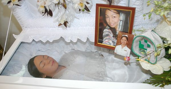mariglo pascual in her open casket during her funeral