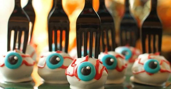 Halloween cake pops with a fork stuck in them! Gross, and easy
