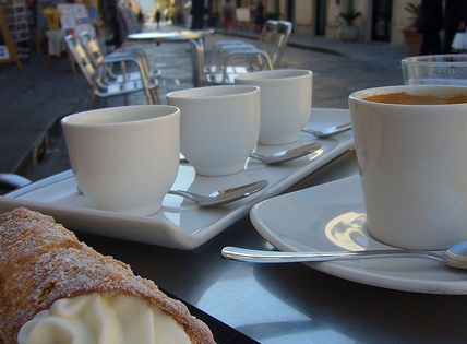 Italian pastry and cups of coffee - photography inside the cafe
