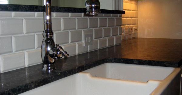 this backsplash is a ceramic tile it is a 2x4 white porcelain tile