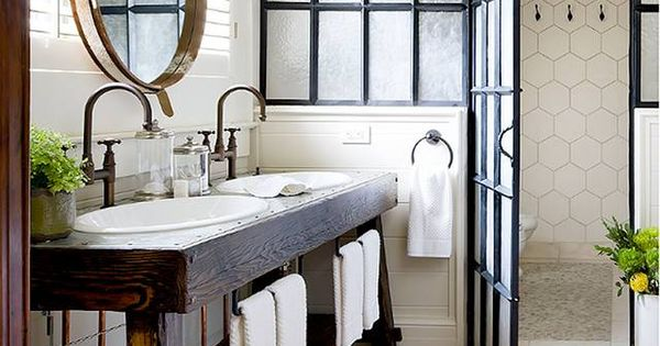 Rustic meets traditional bath. Love the wood sink console, wooden floors, mirror