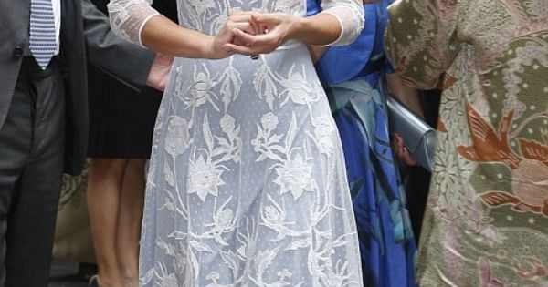 Kate, wearing an elegant ice blue lace dress by Alice Temperley sipped