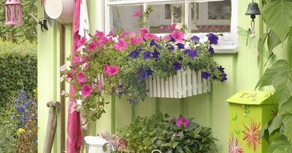lovely little garden shed. Eves, a nice cherry color, pegs, window box