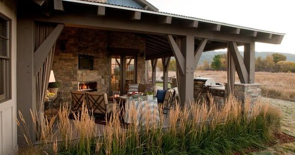 outdoor living room. love the rock, the blue color, the rustic feel
