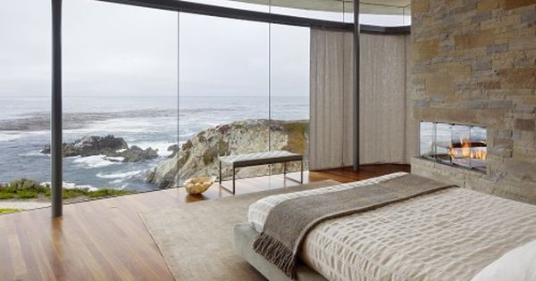 Beach house bedroom - view, windows, fireplace, stone wall