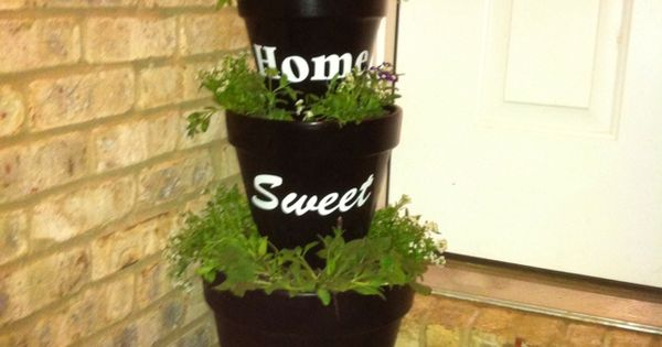 ... yard  Pinterest  This weekend, Stacked flower pots and Flower pots