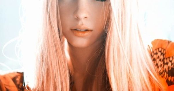 Long Straight Blonde With A Center Part And Pastel Peach