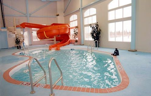 Indoor pool with slide my dream house and everything for Pool design mcmurray