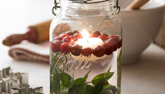 Christmas mason jar decoration: Leaves, cranberries (they float!), and a floating candle.