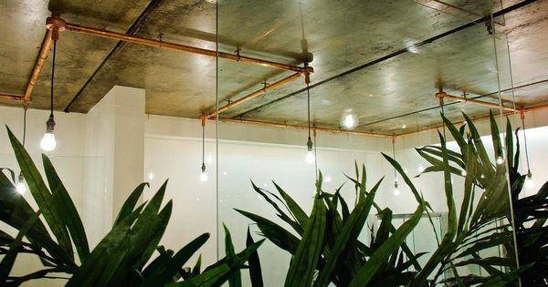 Copper Pipes Create A Lighting Path With Suspended Bulbs