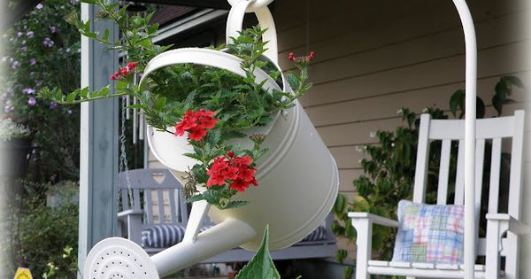 Hanging watering can instead of the typical hanging basket