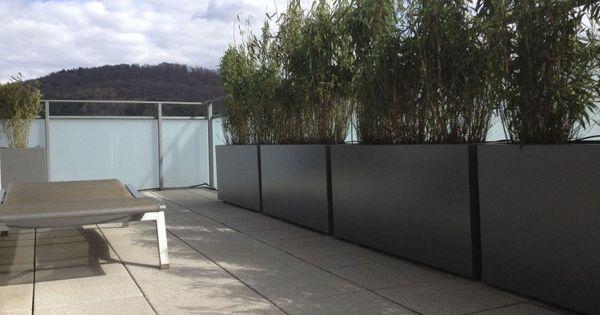 jardini re design en fibre ciment brise vue vert sur le balcon fibre ciment brise vue vert. Black Bedroom Furniture Sets. Home Design Ideas