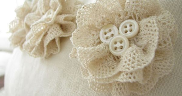 could use white doilies with coral buttons