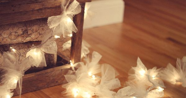 Tie squares of tulle fabric along a string of Christmas lights. |