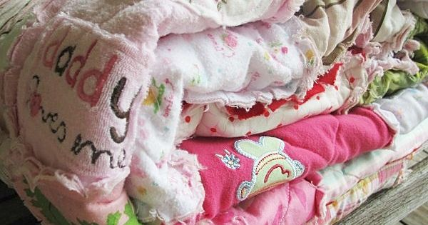 Memory quilt made from old baby clothes~ adorable! First year of clothing