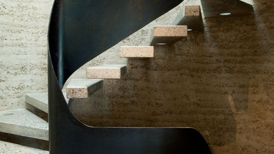 Rammed Earth house. Metal and concrete stairway. stairway staircase
