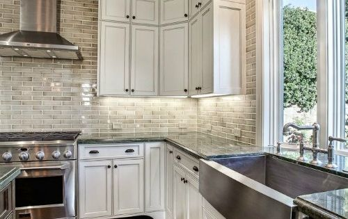 My dream kitchen color scheme, exactly the way I want. Dark floors, white cabinet, subway tile and light countertops.