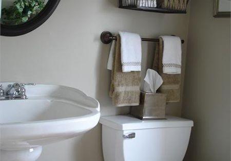 Baskets and towel bar. Creative Bathroom Storage Ideas | Shelterness Decorative garden