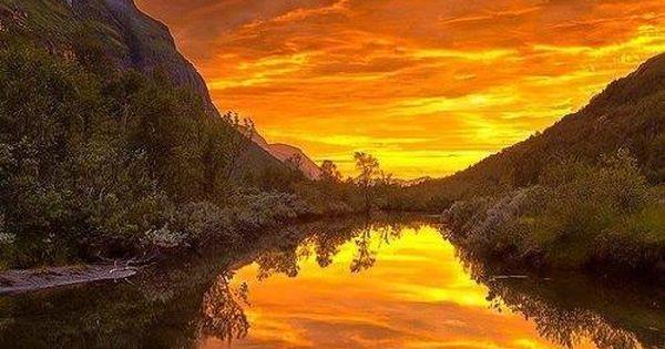 Orange skies over a lake in Norway.