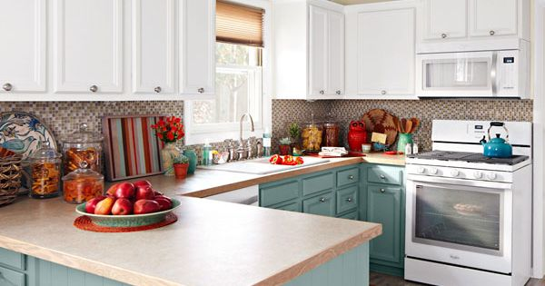 White kitchen with cabinet crown moulding saw this in for Assembled kitchen cabinets lowes