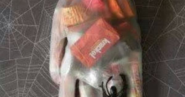 "Halloween Party Goodie ""Bag""... Pinner says: I used surgical gloves that you"