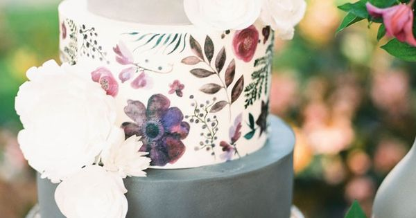 Gorgeous grey and white cake decorated with hand-painted botanicals