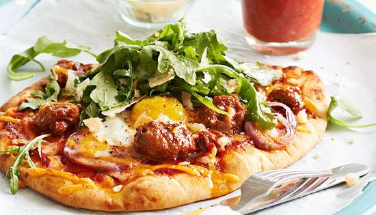Breakfast Pizza, Eggs and Greens Breakfast sausage and fried eggs turn a