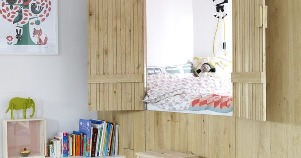 Built-in bed nook that can open and close for a kid's room