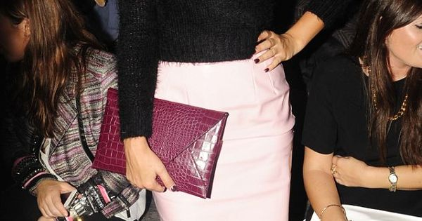 Strong lip, black top, pale pink pencil skirt