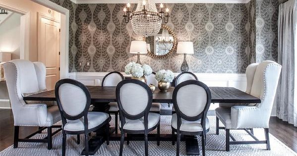 elegant dining table features an octagon tray ceiling accented with a