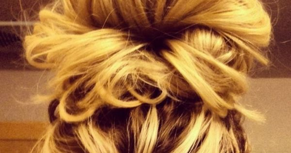 Messy bun hairstyle. 2 elastics. 1 at the scalp - high pony