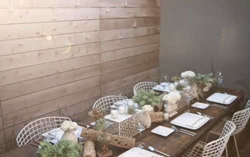 Wood patio tables with wire chairs.