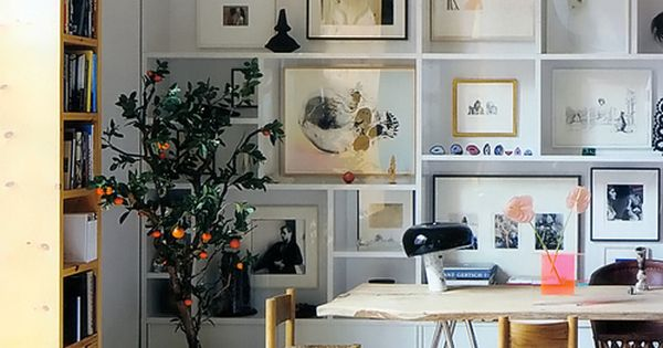high ceilings floor to ceiling shelving gallery, reclaim wood table and nice