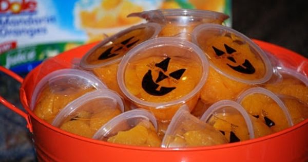 Cute, healthy Halloween treat- can use mandarin oranges or peaches. Trick or