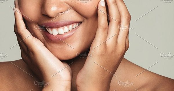 Closeup of a pretty young woman with perfect healthy skin on grey background. Natural Beauty with fresh and clean skin.