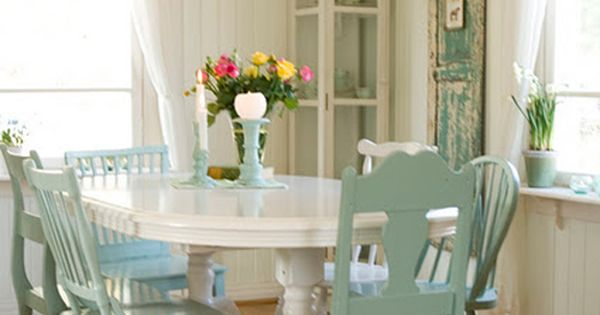 mismatched chairs all painted the same color. Like the blue chairs with