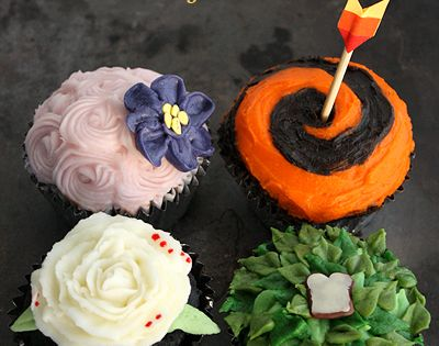 hunger games cupcakes. boy witht the bread is there. the girl on