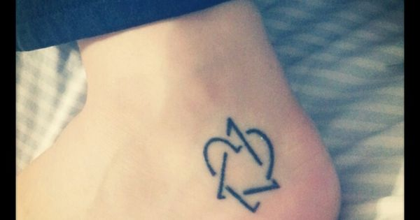 My tattoo of the adoption symbol the triangle represents for Tattoos symbolizing parents